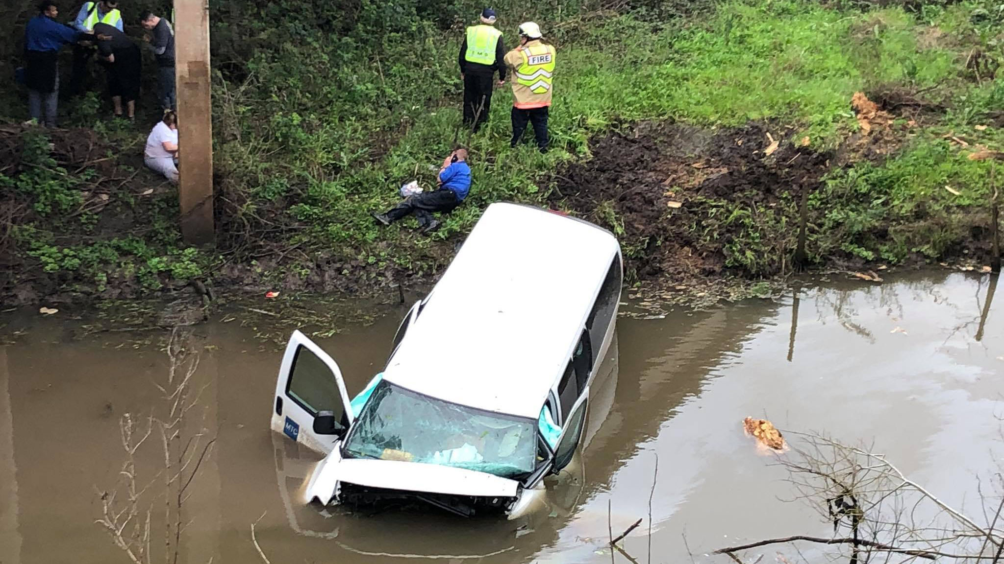 Van carrying inmates crashes into water in Wharton