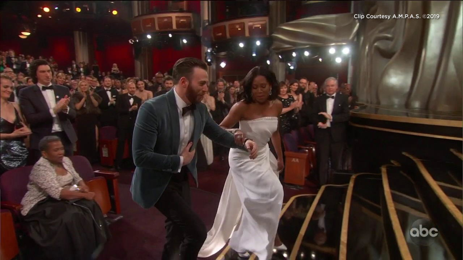 OSCARS 2019: Chris Evans lends Regina King helping hand to ...