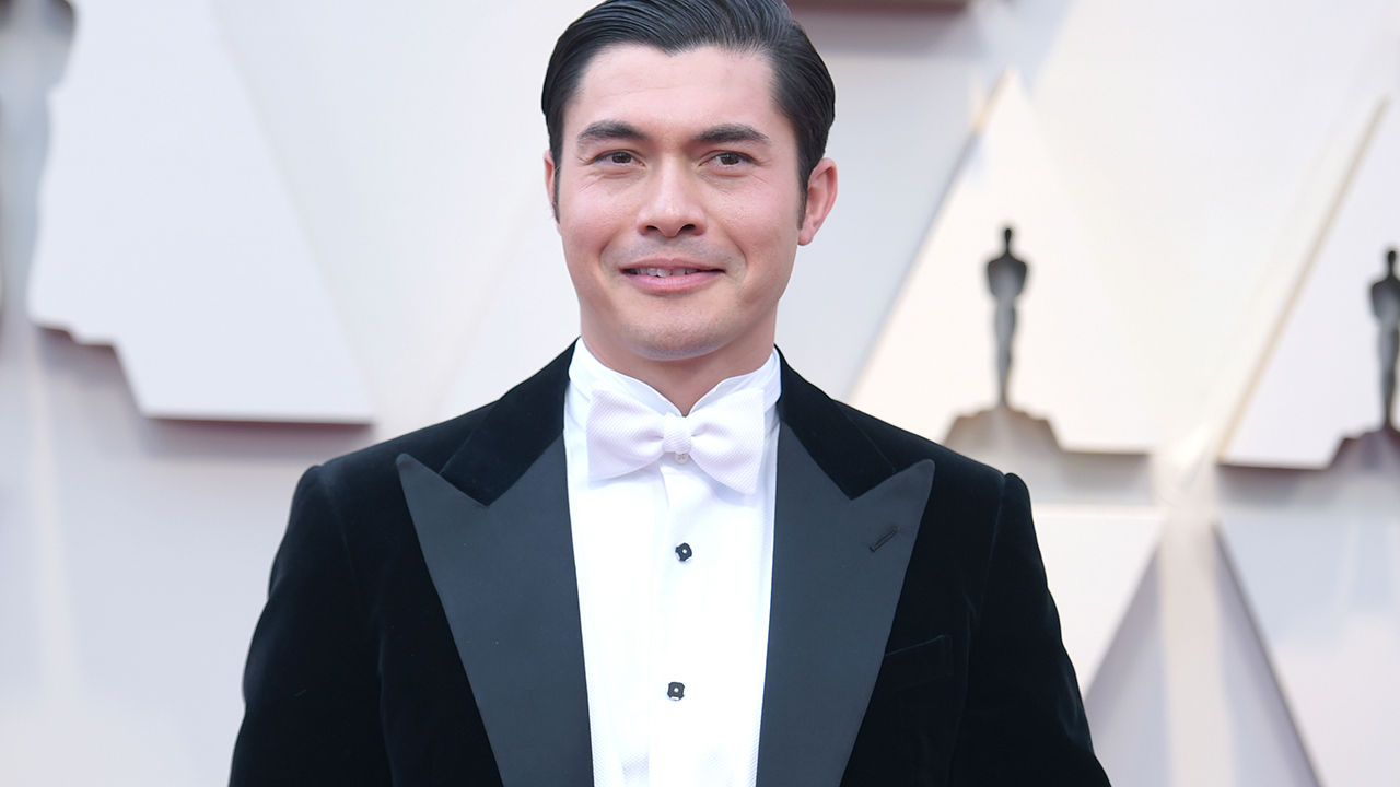 Henry Golding arrives at the Oscars on Sunday, Feb. 24, 2019, at the Dolby Theatre in Los Angeles.