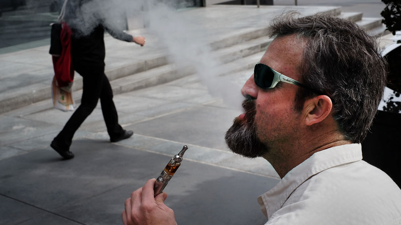 Man smoking electronic cigarette