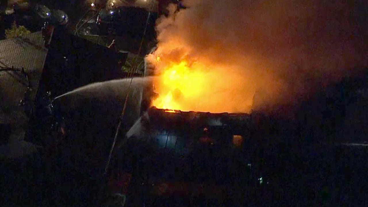 Firefighters battle a 3-alarm fire in Garden Grove on Thursday, Feb. 12, 2015.