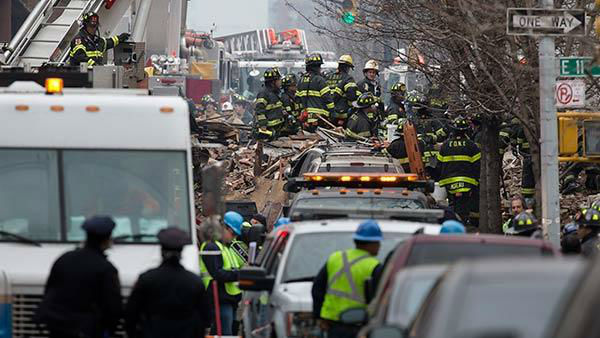 """<div class=""""meta image-caption""""><div class=""""origin-logo origin-image """"><span></span></div><span class=""""caption-text"""">Firefighters work the scene of an explosion that leveled two apartment buildings in the East Harlem neighborhood of New York, Wednesday, March 12, 2014. (AP Photo/John Minchillo)</span></div>"""