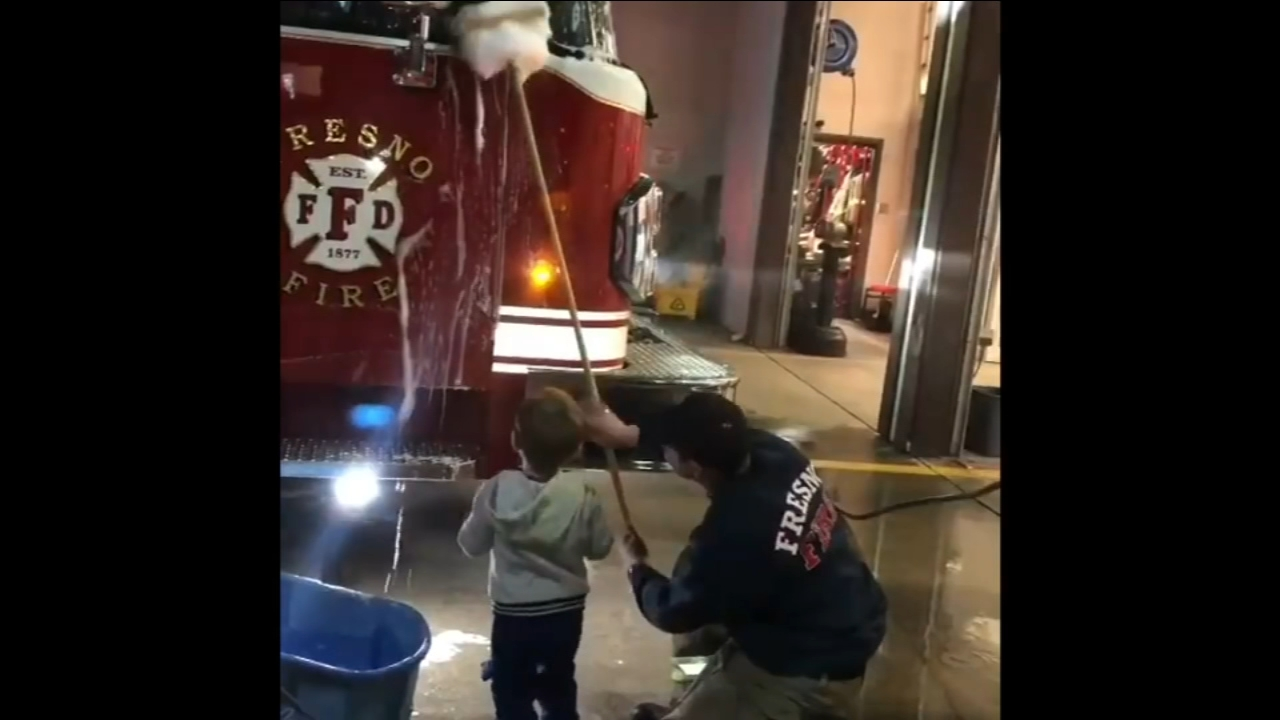 Firefighting toddler helps Fresno crews clean fire engine