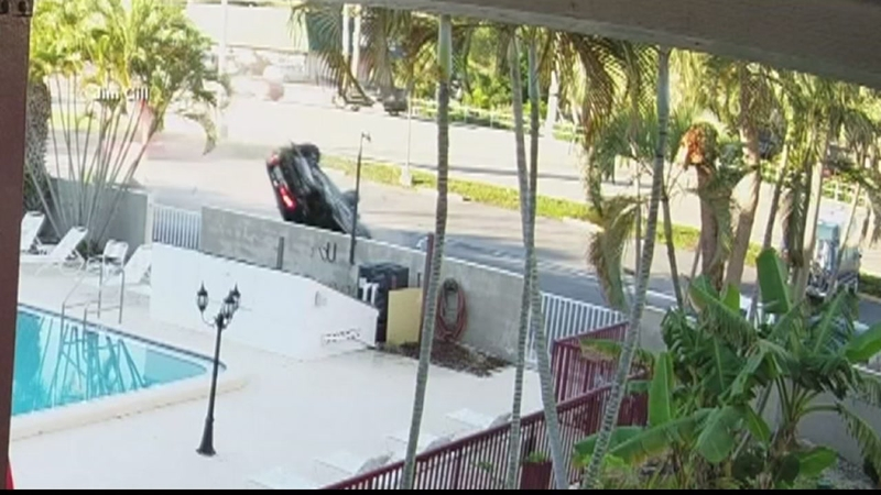 Hit-and-run sends car flipping into parking lot, swimming pool gate