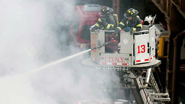 """<div class=""""meta image-caption""""><div class=""""origin-logo origin-image """"><span></span></div><span class=""""caption-text"""">Firefighters respond to a fire on 116th Street in Harlem after a building exploded, leading to the collapse of at least one building and several injuries. (AP Photo/John Minchillo)</span></div>"""