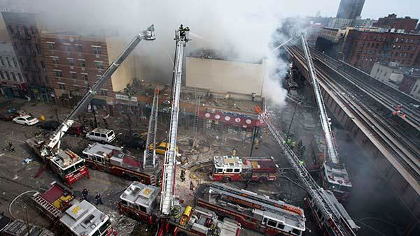 """<div class=""""meta image-caption""""><div class=""""origin-logo origin-image """"><span></span></div><span class=""""caption-text"""">Firefighters battle a fire after a building collapse in the East Harlem neighborhood of New York, Wednesday, March 12, 2014. (AP Photo/John Minchillo)</span></div>"""