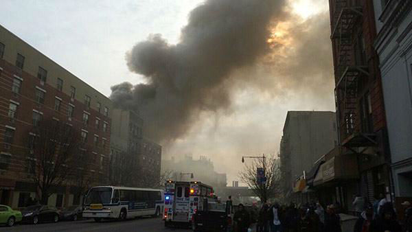 """<div class=""""meta image-caption""""><div class=""""origin-logo origin-image """"><span></span></div><span class=""""caption-text"""">In this photo provided by Shane Kennedy, smoke rises from the site of an explosion and building collapse near Park Avenue and 116th Street in East Harlem on March 12, 2014. (AP Photo/Shane Kennedy)</span></div>"""