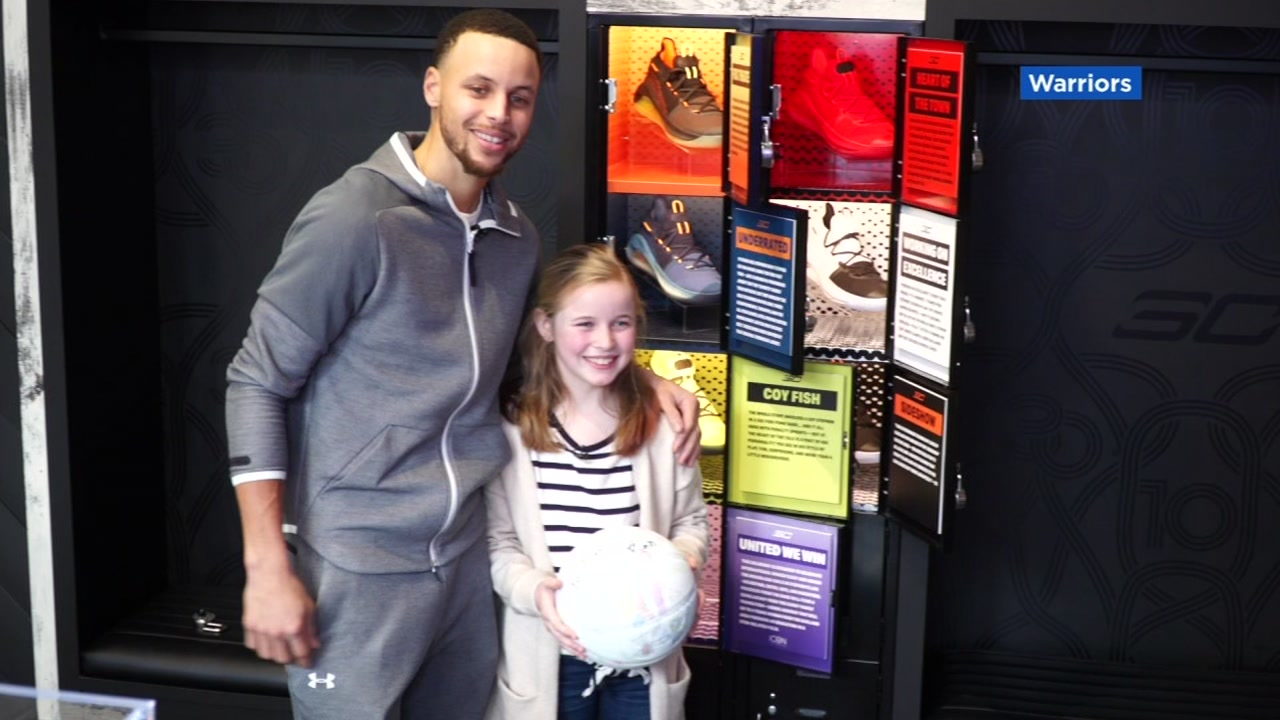 Stephen Curry and Riley Morrison pose for a photograph on Thursday, March 7, 2019 in Oakland, Calif.