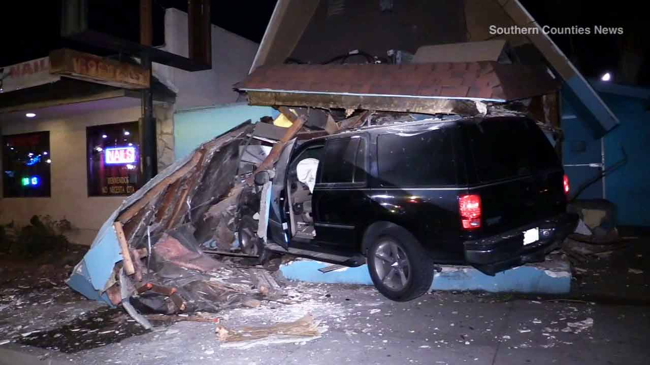 A woman accidentally put her foot on the gas pedal and plowed into a bar in Santa Ana, causing the structure to be red-tagged on Friday, Feb. 13, 2015.
