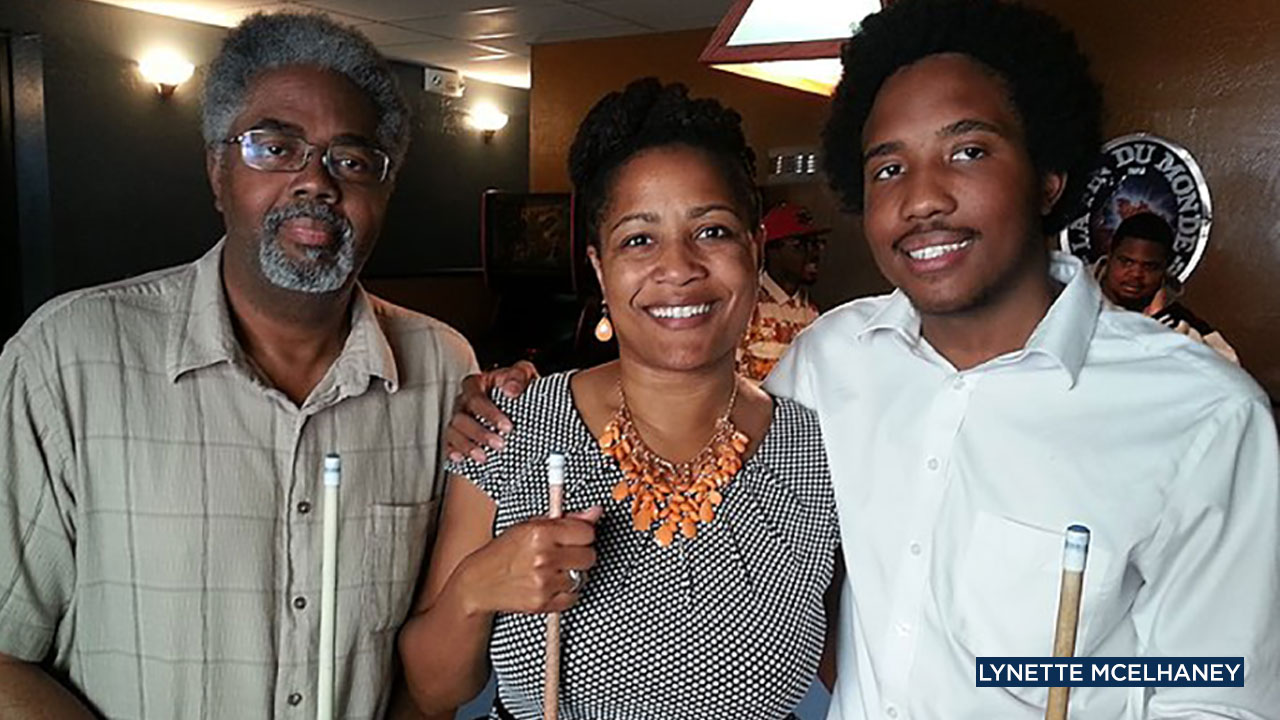 Shooting victim Victor McElhaney (right) with his mother Lynette and father Clarence, celebrating his 21st birthday at a bar in Oakland.