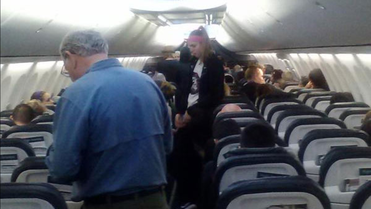 A photo shows the inside of Alaska Airlines Flight 567, where a woman was stung by a scorpion on Saturday, Feb. 14, 2015.