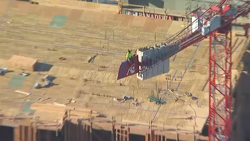 Distressed man dangles from crane for 3 hours in Koreatown