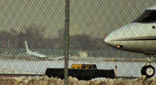 """<div class=""""meta image-caption""""><div class=""""origin-logo origin-image none""""><span>none</span></div><span class=""""caption-text"""">A twin engine plane ran off the runway while landing at Midway Airport Monday, February 16, 2015. (WLS Photo/ BILL POTURICA)</span></div>"""