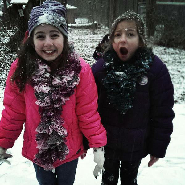 """<div class=""""meta image-caption""""><div class=""""origin-logo origin-image none""""><span>none</span></div><span class=""""caption-text"""">These girls are definitely enjoying the winter weather.</span></div>"""