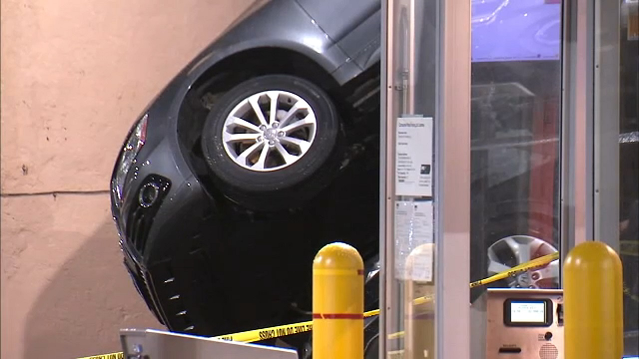 Parked car dropped onto another car in Brooklyn garage lift fail