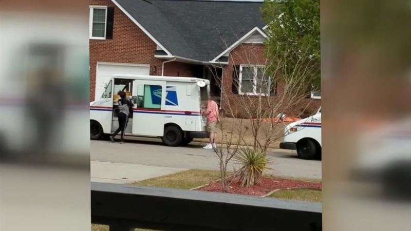 Fayetteville postal worker tosses packages inside truck