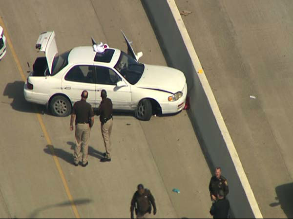 """<div class=""""meta image-caption""""><div class=""""origin-logo origin-image none""""><span>none</span></div><span class=""""caption-text"""">Authorities say a suspect who tried to flee on foot ended up getting hit by an oncoming vehicle on Highway 59 near Highway 99 (Photo/KTRK)</span></div>"""