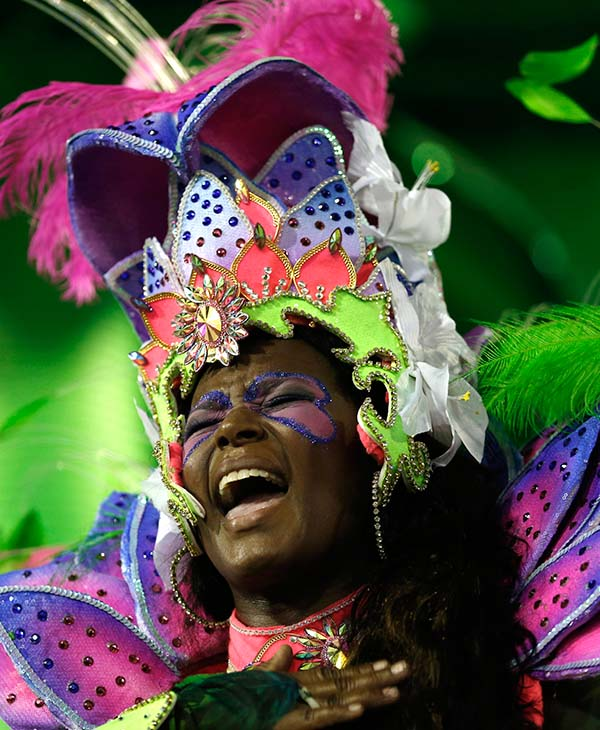 "<div class=""meta image-caption""><div class=""origin-logo origin-image ap""><span>AP</span></div><span class=""caption-text"">A performer from the Portela samba school sings out during Carnival celebrations at the Sambadrome in Rio de Janeiro, Brazil, Monday, Feb. 16, 2015.</span></div>"