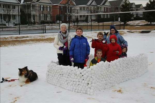 "<div class=""meta image-caption""><div class=""origin-logo origin-image none""><span>none</span></div><span class=""caption-text"">Carpenter Village kids show off their snow Fortress (WTVD Photo/ Travis G.)</span></div>"