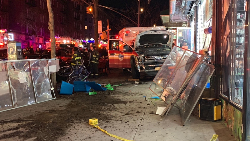 Ambulance rushing to call jumps curb, hits storefront after crash