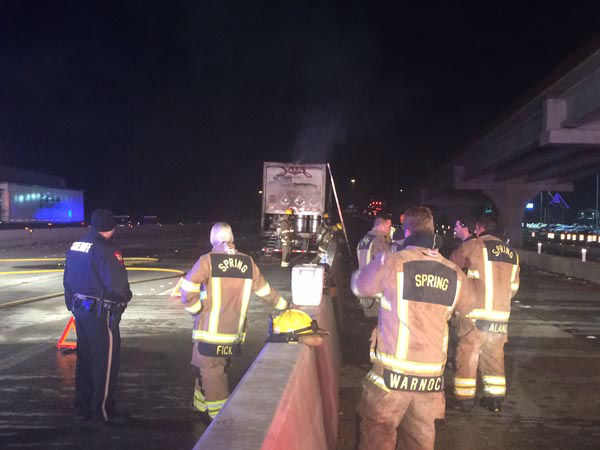"""<div class=""""meta image-caption""""><div class=""""origin-logo origin-image none""""><span>none</span></div><span class=""""caption-text"""">Harris County Hazmat is cleaning up after a big rig caught fire on I-45 at Northgate Crossing in Spring (KTRK Photo/ Scott Engle)</span></div>"""
