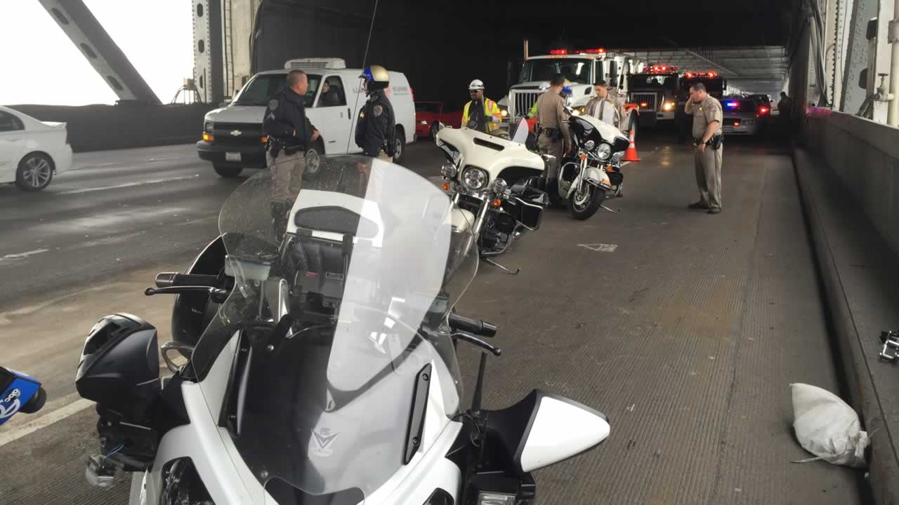 A minor accident involving a CHP motorcycle officer shut down two lanes of the Bay Bridge and caused traffic delays.