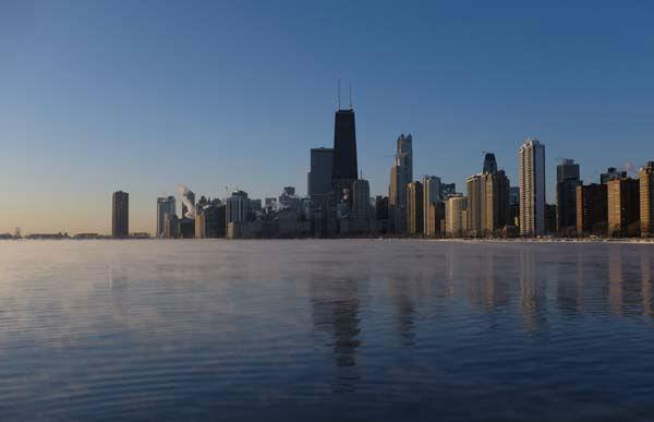 "<div class=""meta image-caption""><div class=""origin-logo origin-image none""><span>none</span></div><span class=""caption-text"">The sun rises on Lake Michigan as ice forms along the shore, Thursday, Feb. 19, 2015, in Chicago. (Photo/Kiichiro Sato)</span></div>"