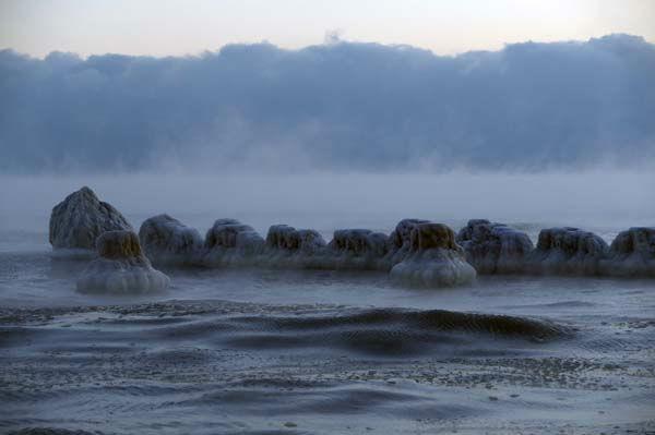 "<div class=""meta image-caption""><div class=""origin-logo origin-image none""><span>none</span></div><span class=""caption-text"">Ice forms along the shore of Lake Michigan, Thursday, Feb. 19, 2015, in Chicago. (AP Photo/ Kiichiro Sato)</span></div>"