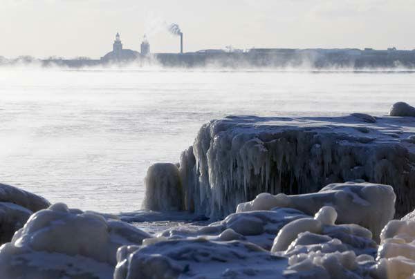 "<div class=""meta image-caption""><div class=""origin-logo origin-image none""><span>none</span></div><span class=""caption-text"">Ice forms along the shore on Lake Michigan, Thursday, Feb. 19, 2015, in Chicago. (AP Photo/ Kiichiro Sato)</span></div>"
