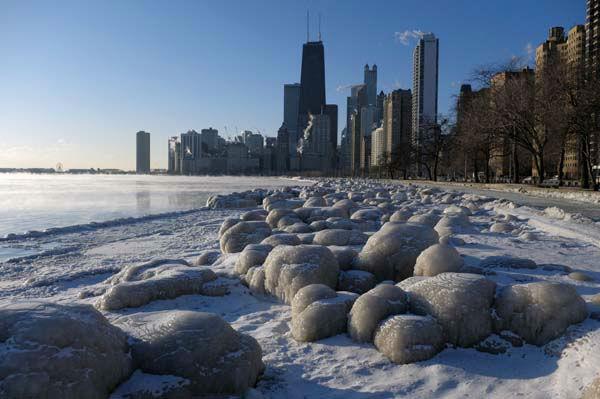 "<div class=""meta image-caption""><div class=""origin-logo origin-image none""><span>none</span></div><span class=""caption-text"">Ice forms along the shore of Lake Michigan, Thursday, Feb. 19, 2015, in Chicago. (Photo/Kiichiro Sato)</span></div>"