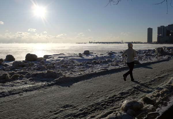 "<div class=""meta image-caption""><div class=""origin-logo origin-image none""><span>none</span></div><span class=""caption-text"">A runner jogs along Lake Michigan as ice forms on the shore Thursday, Feb. 19, 2015, in Chicago. (AP Photo/ Kiichiro Sato)</span></div>"