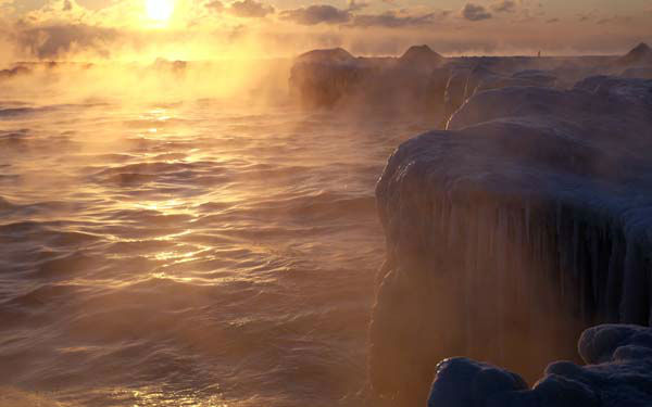"<div class=""meta image-caption""><div class=""origin-logo origin-image none""><span>none</span></div><span class=""caption-text"">The sun rises on Lake Michigan as ice forms along the shore, Thursday, Feb. 19, 2015, in Chicago. (AP Photo/ Kiichiro Sato)</span></div>"