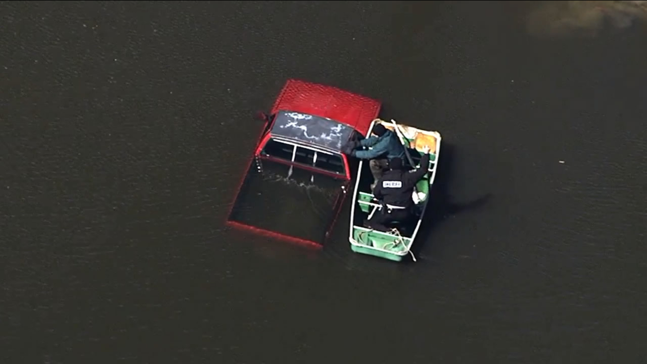 Images from Chopper 11 HD showed a little red truck submerged in a Wendell pond near Blair Hills Road at Lake Glad Road.