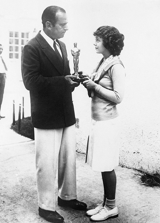 <div class='meta'><div class='origin-logo' data-origin='AP'></div><span class='caption-text' data-credit=''>Janet Gaynor, actress chosen by the Academy of Motion Picture Arts and Sciences, receives the 1929 award of the trophy from Doug Fairbanks, President of the Academy May 19, 1929.</span></div>