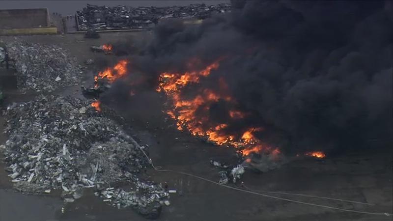 Large fire burning at scrap metal yard in Jersey City