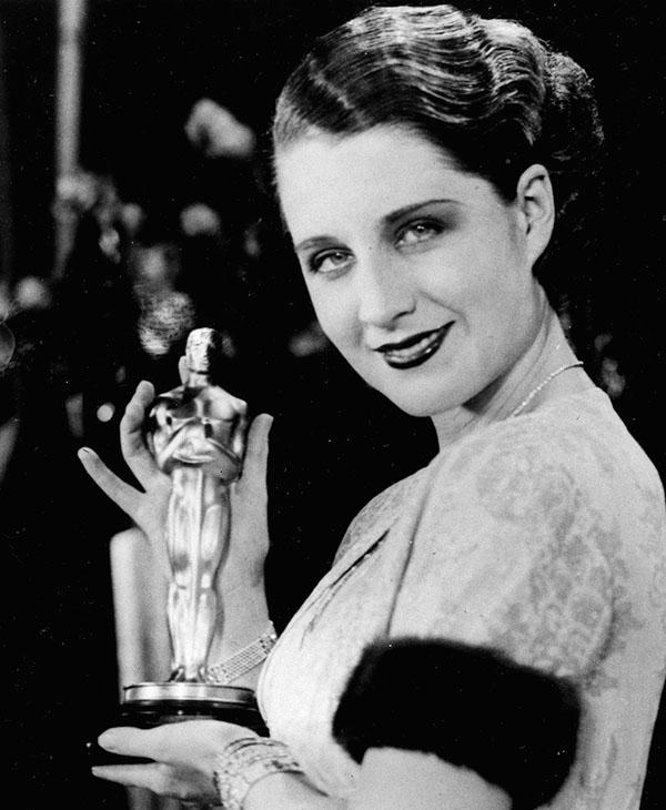 <div class='meta'><div class='origin-logo' data-origin='AP'></div><span class='caption-text' data-credit=''>Actress Norma Shearer poses with her Oscar at the Academy Awards banquet in the Fiesta Room, Ambassador Hotel in Los Angeles, Ca., Nov. 5, 1930.</span></div>