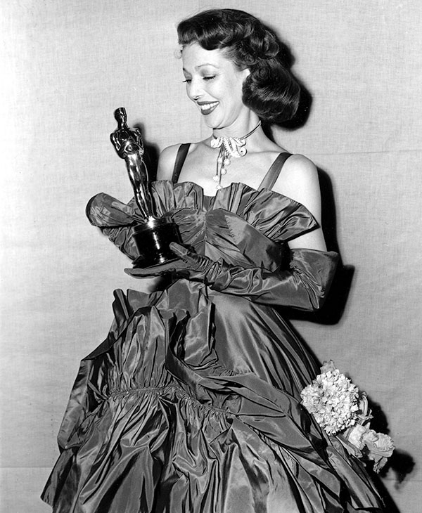 <div class='meta'><div class='origin-logo' data-origin='AP'></div><span class='caption-text' data-credit=''>Loretta Young looks at her Oscar at the 1947 Academy Awards held at the Shrine Civic Auditorium in Los Angeles, Ca., on March 20, 1948.</span></div>