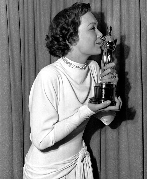 <div class='meta'><div class='origin-logo' data-origin='AP'></div><span class='caption-text' data-credit=''>Jane Wyman kisses her Oscar awarded her in Hollywood for her Best Actress role in &#34;Johnny Belinda&#34; in this March 24,1949 photo.</span></div>