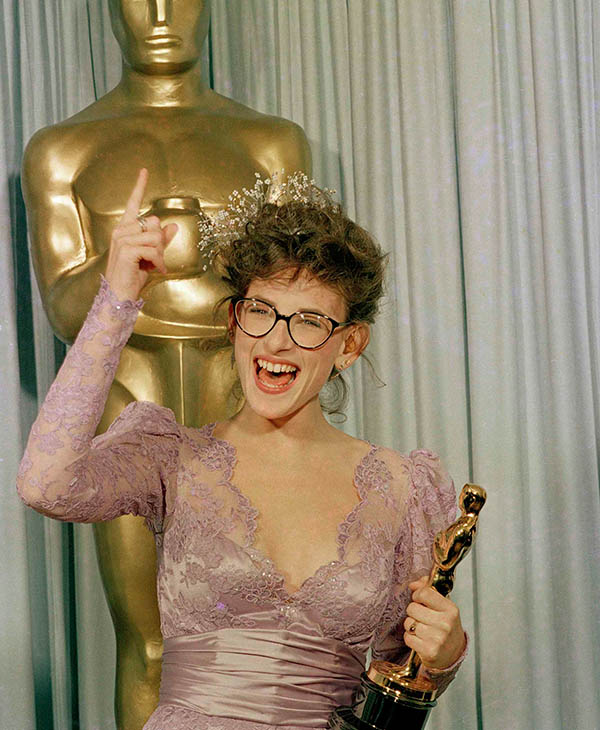 <div class='meta'><div class='origin-logo' data-origin='AP'></div><span class='caption-text' data-credit=''>A radiant Marlee Matlin signs her jubilation as she presents Oscar backstage at the Dorothy Chandler Pavilion in Los Angeles, March 31, 1987.</span></div>
