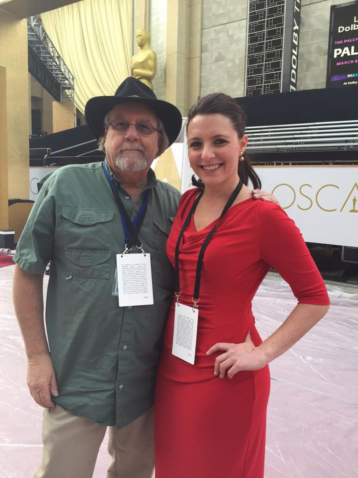 """<div class=""""meta image-caption""""><div class=""""origin-logo origin-image kgo""""><span>KGO</span></div><span class=""""caption-text"""">ABC7 News Reporter Katie Marzullo and photographer Michael Clark stand on the 87th Oscars red carpet in Hollywood, Calif. on Feb. 20, 2015. (KGO-TV/Katie Marzullo)</span></div>"""