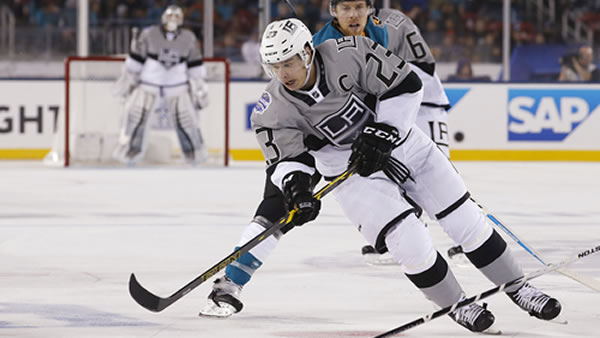 Los Angeles Kings' Dustin Brown (23) is chased by San Jose Sharks' Joe Pavelski during the second period of an NHL hockey game Saturday, Feb. 21, 2015.