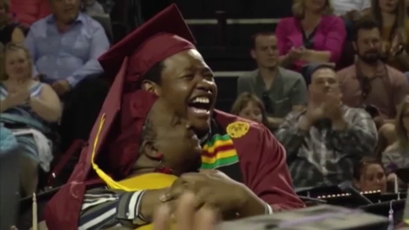 Mother skips her own graduation to attend son's
