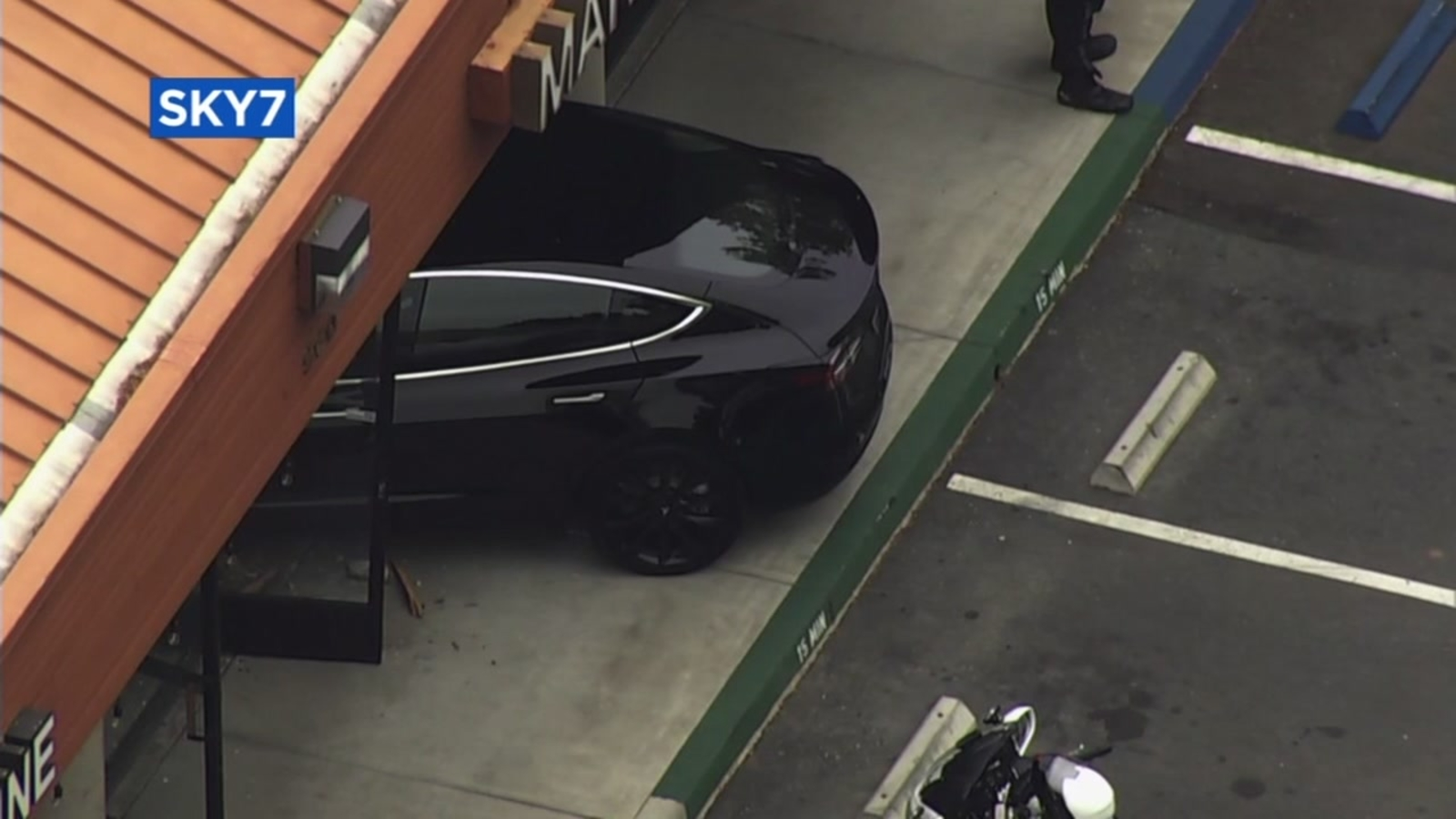 Tesla smashes through laundry service store in East Bay