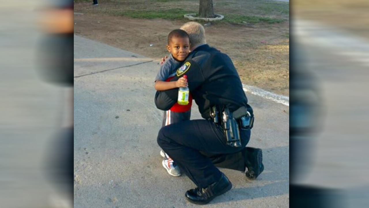 Officer hugs boy