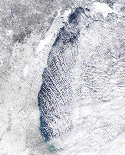 """<div class=""""meta image-caption""""><div class=""""origin-logo origin-image none""""><span>none</span></div><span class=""""caption-text"""">An iced-over Lake Michigan is shown in this photo from February 2015. (Great Lakes Surface Environmental Analysis (GLSEA))</span></div>"""