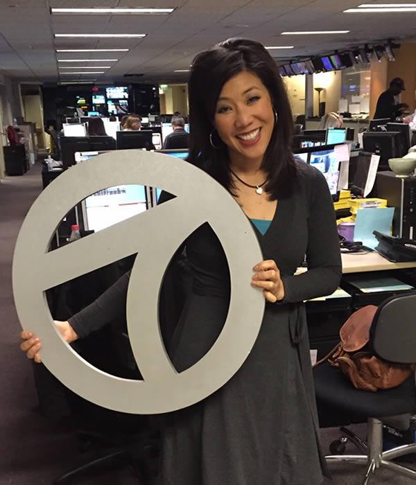 """<div class=""""meta image-caption""""><div class=""""origin-logo origin-image none""""><span>none</span></div><span class=""""caption-text"""">ABC7 News Anchor Kristen Sze poses for a photo to show off her Super Bowl 50 spirit. (KGO-TV/ABC7 News)</span></div>"""