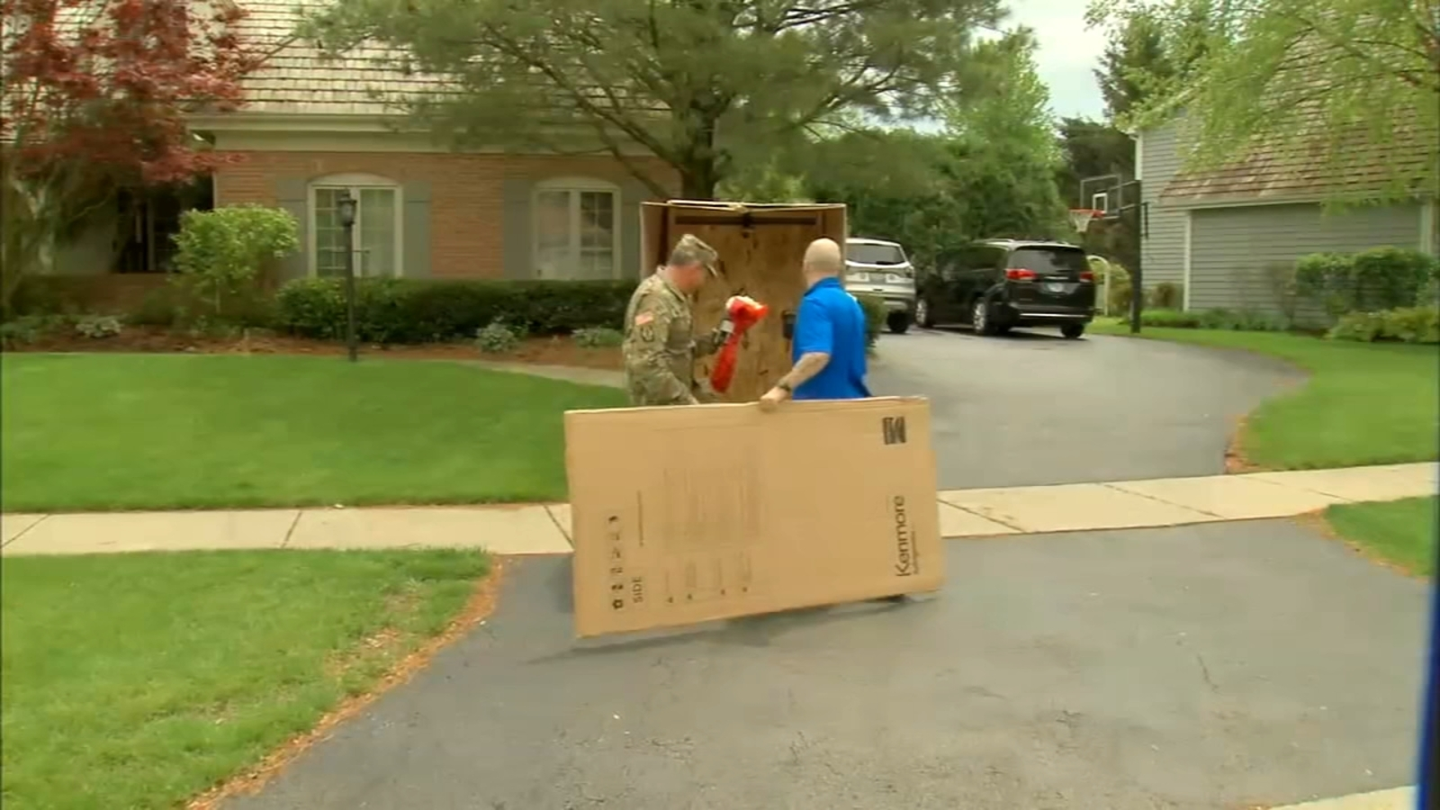 St. Charles military dad disguised as grill comes home early, surprises wife, kids
