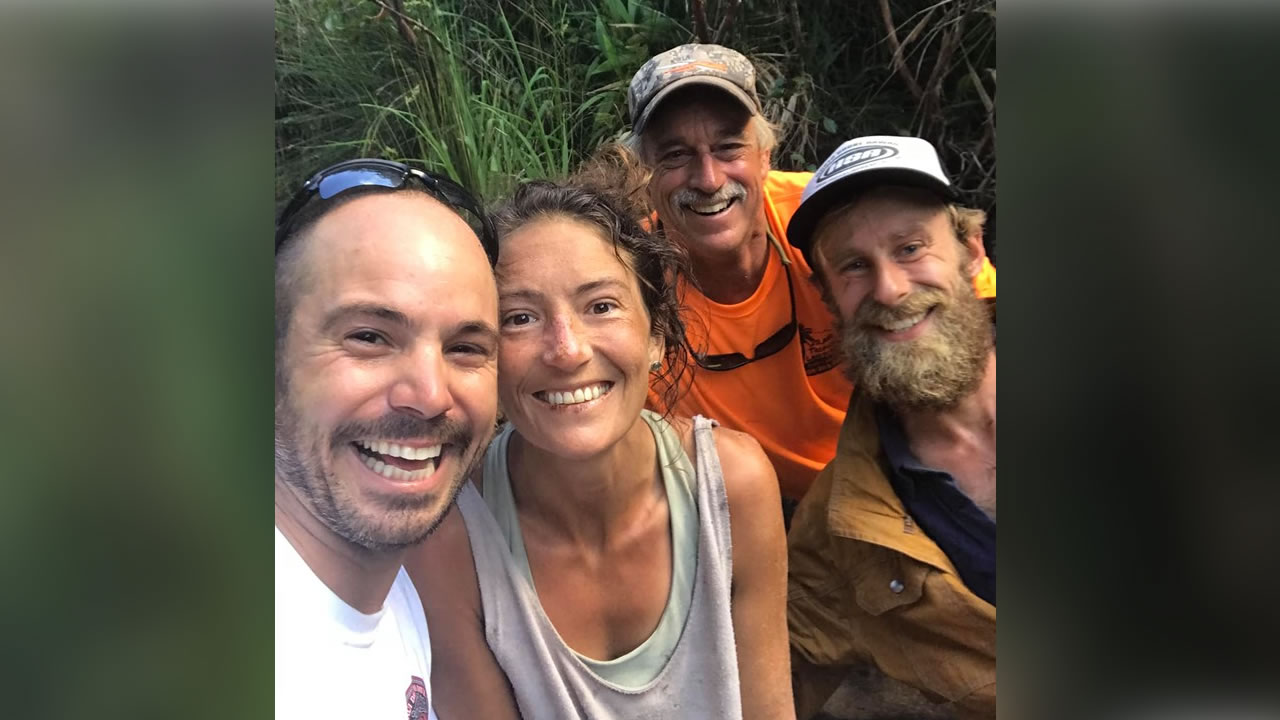 This May 2019 image shows Amanda Eller with her rescuers after she went missing for more than 2 weeks in Maui.