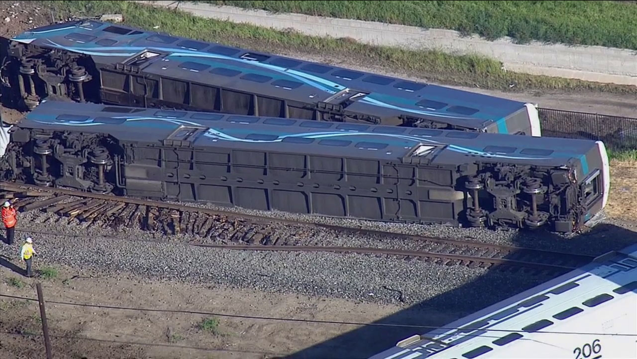 Metrolink train cars are seen on their side after a crash in Oxnard on Tuesday, Feb. 24, 2015.