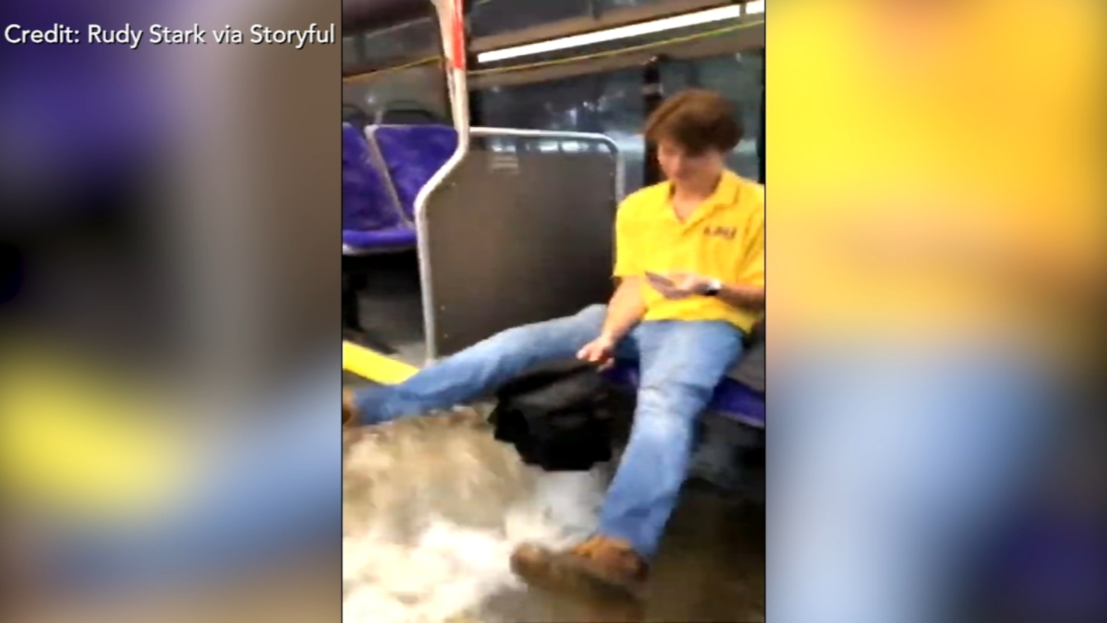 Flood waters sweep through bus as college students ride to class